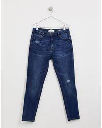 Jeans carrot affusolati blu scuro con strappo sul ginocchio di Pull&Bear in Blue da Uomo