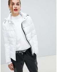 83aabc4147 Women's White Short Padded Jacket With Branded Taping