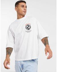 T-shirt oversize con piccolo pesce e scritta sul petto di ASOS in White da Uomo