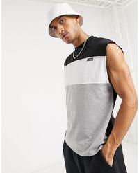 Camiseta extragrande sin mangas con paneles monocromos en contraste ASOS de hombre de color Gray
