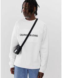 Calvin Klein Jeans – Lockeres Sweatshirt mit Logo in White für Herren