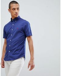 c52f14348 Polo Ralph Lauren. Blue Garment Dyed Slim Fit Short Sleeve Button-down Shirt  With Player Logo In Navy