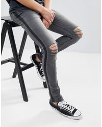 ASOS Super Skinny Jeans In Washed Black With Side Stripe And Knee Rips for men