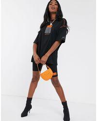T-shirt oversize à motif The Couture Club en coloris Black