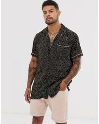 Premium - Camicia a maniche corte nera con stampa animalier e rever di Jack & Jones in Black da Uomo