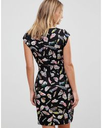 Trollied Dolly Black Crossover Dress In Feather Print