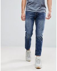 River Island Tapered Jeans In Dark Blue Wash for men