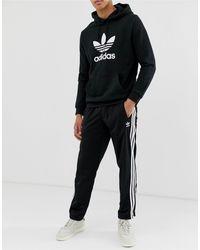 Adidas Originals – Firebird – e Jogginghose in Black für Herren