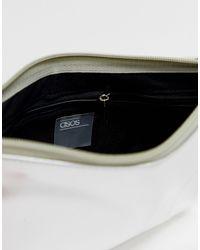 Pochette metallica con zip e cinturino per il polso di ASOS