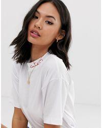 T-shirt droit à jolie broderie ASOS en coloris White