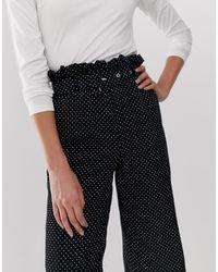 Pantaloni a pois con cintura di UNIQUE21 in Black