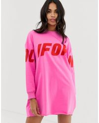 Robe sweat à inscription California - fluo Boohoo en coloris Pink