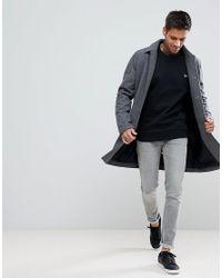Lacoste Logo Crew Neck Sweater In Black for men