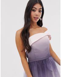 Robe mi-longue en tulle coupe asymétrique avec effet dip-dye Chi Chi London en coloris Pink