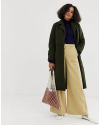 Cappotto di lana con cintura di Minimum in Green