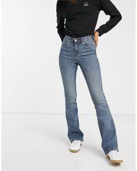 Jeans a zampa skinny a vita alta lavaggio autentico di Dr. Denim in Blue
