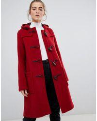 Trenca con capucha y paneles en la zona media Gloverall de color Red