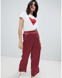 Pantalon loose à rayures Soaked In Luxury en coloris Red
