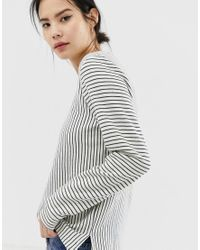 Top a righe a maniche lunghe di Ichi in White