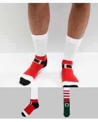 Pack de 2 calcetines de Pap Noel y elfo de ASOS ASOS de hombre de color Red