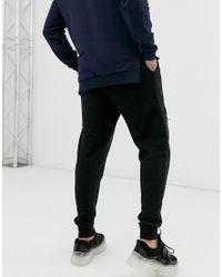 Joggers fuselé en jersey avec poche niveau cuisse ASOS pour homme en coloris Black