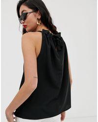 Top sans manches à col froncé NA-KD en coloris Black