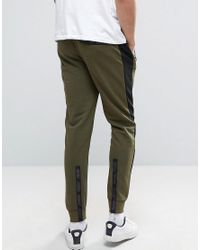 PUMA - Tapered Joggers In Green for Men - Lyst
