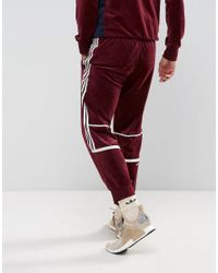 skate shoes shades of low price sale adidas Originals Cotton Challenger Velour Track Jogger In ...