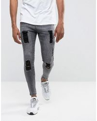 Illusive London Super Skinny Jeans In Acid Wash Black With Distressing for men