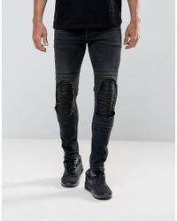 Vaqueros muy ajustados en negro desgastado con rasgados de efecto cuero y diseo motero de ASOS ASOS de hombre de color Black