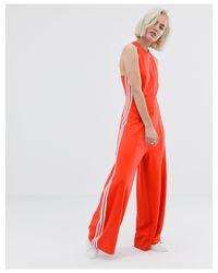 Tuta jumpsuit sartoriale rossa di Adidas Originals in Red