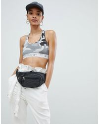 5255e318df129 Stussy Bralet With Logo Taping In Camo - Lyst