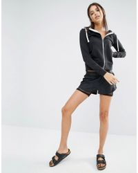 Reebok   Black Shorts In Embossed Snake Print With Exposed Waistband   Lyst