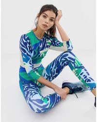 Leggings con estampado animal y recortes ASOS 4505 de color Blue
