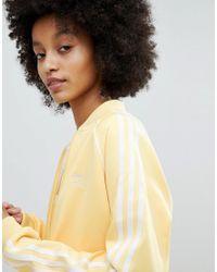 Adidas Originals Originals Adicolor Three Stripe Track Jacket In Yellow