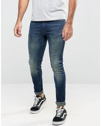 ASOS Extreme Super Skinny Jeans In Dirty Dark Blue Wash for men