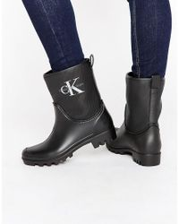 Calvin Klein | Black Jeans Philippa Ankle Wellington Boots | Lyst