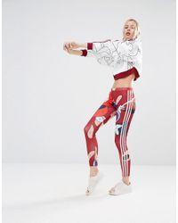220d27bb845 adidas Originals. Women's Red Originals X Rita Ora Paint Print Three Stripe  Leggings