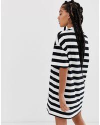 Robe t-shirt à rayures - Noir et blanc Collusion en coloris Black