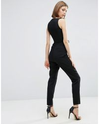 Lavish Alice Black Lace Up Plunge Tapeleg Jumpsuit