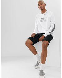 T-shirt décontracté à manches longues avec imprimé historique sur la manche et le devant ASOS pour homme en coloris White