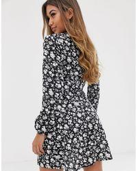 Robe à fleurs style portefeuille Missguided en coloris Black