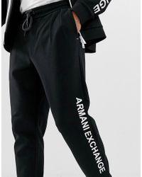 Joggers en molleton avec logo sur le côté - Noir Armani Exchange pour homme en coloris Black