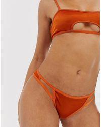 Tanga con aberturas en color teja metálico Odeda ASOS de color Orange