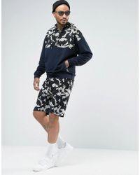 ASOS Blue Oversized Hoodie With Half Zip Camo Print for men