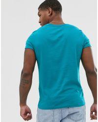 Pack de 3 camisetas con cuello redondo y manga enrollada ASOS de hombre de color Blue