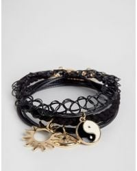 ASOS - Black Pack Of 4 Tattoo And Charm Layering Bracelets - Lyst