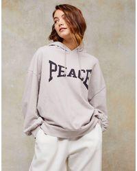 """Felpa con cappuccio grigia con scritta """"Peace"""" di TOPSHOP in Gray"""