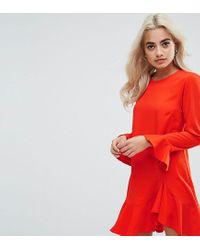 Vestitino con maniche svasate e fondo a volant di ASOS in Orange