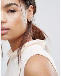 Nylon - Metallic Star Burst Earrings - Lyst